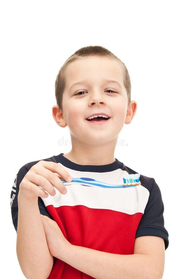 Auftragende Zähne des kleinen Jungen lizenzfreie stockfotografie