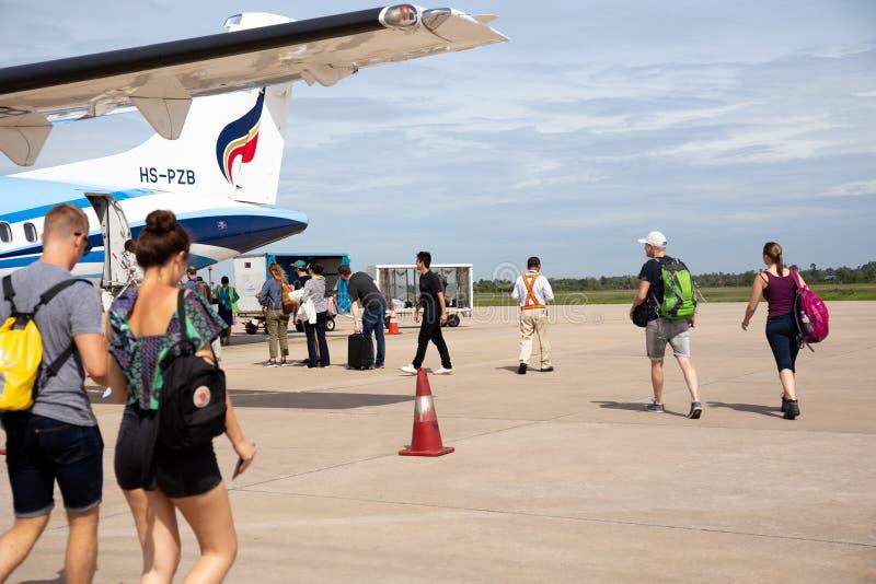 Aug 30,2018 -Bangkok airways airplane with passengers getting in ATR plane. royalty free stock image