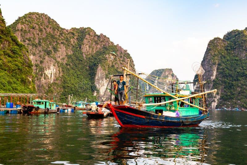 Aug 2016 - Halong Bay, Vietnam – Fishermen boats in Halong Bay royalty free stock photo