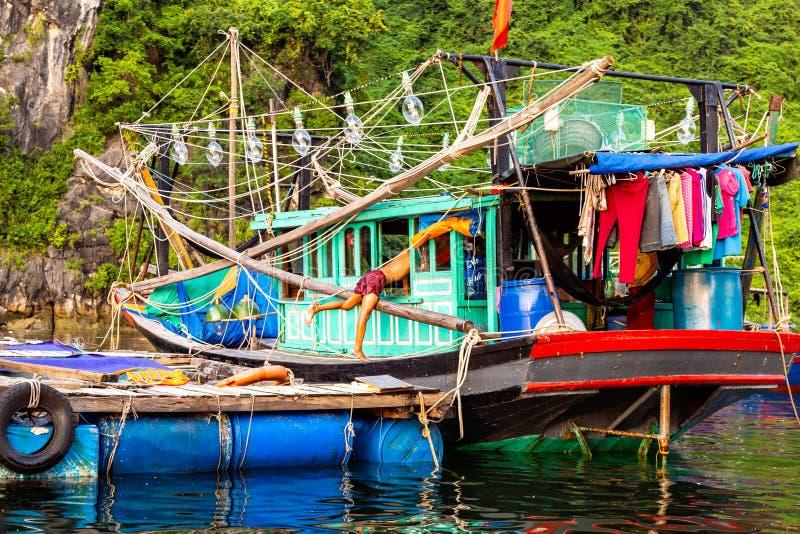 Aug 2016 - Halong Bay, Vietnam – Fishermen boats in Halong Bay stock photography