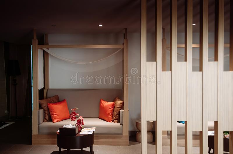 Colourful modern furniture, Sofa couch and coffee table. AUG 6, 2014 Hua Hin, THAILAND - Colourful modern furniture, wooded, sofa couch in Asian style hotel room royalty free stock images