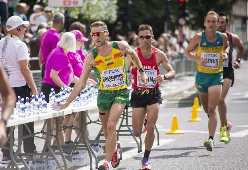 6 Aug `17 - London World Athletics Championships marathon: Ignas Brasevicius LIT, Leslie Enchina CHI and Josh Harris AUS. 6 August 2017, London: Ignas royalty free stock images