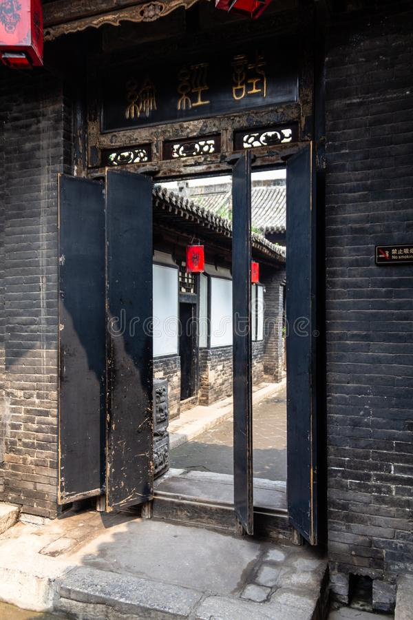 Aug 2013 - Pingyao, Shanxi province, China - Wooden panels door in one of the courtyards of Ri Sheng Chang,. The oldest bank in the world in Pingyao Ancient royalty free stock photos