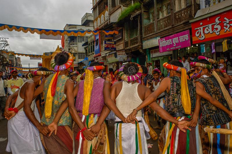 Tribal divotis dancing on occasion of baps swaminarayan mandir nagar yatra Dhule Maharashtra. 07-Aug-2010-Tribal divotis dancing on occasion of baps swaminarayan stock photography