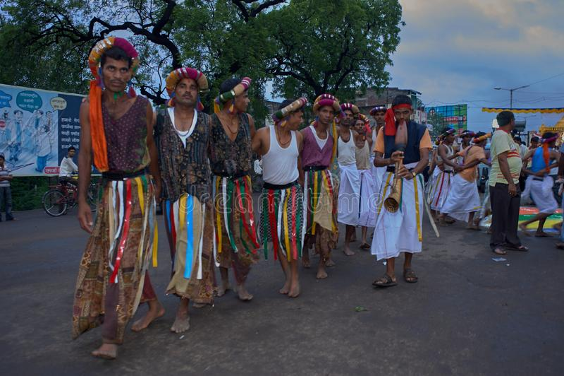 Tribal divotis dancing on occasion of baps swaminarayan mandir nagar yatra Dhule Maharashtra. 07-Aug-2010-Tribal divotis dancing on occasion of baps swaminarayan stock images
