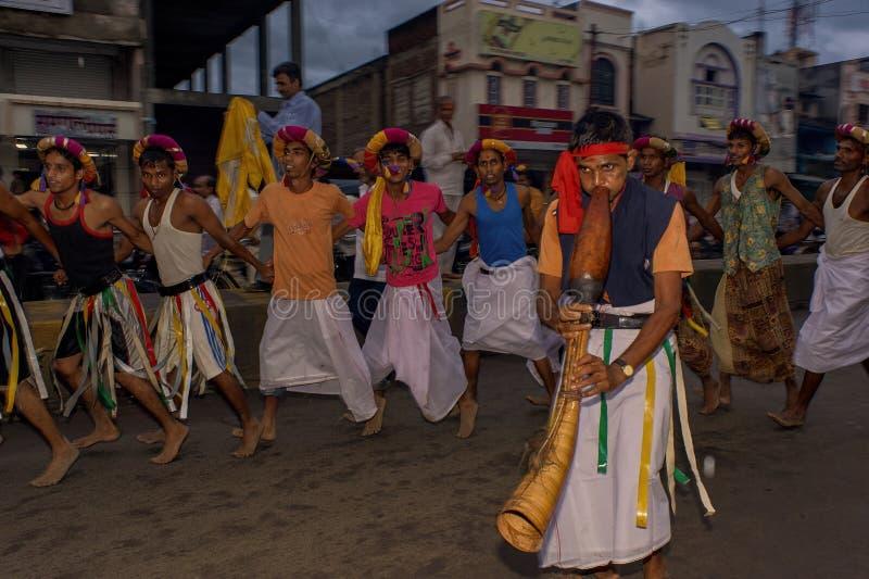 Tribal divotis dancing on occasion of baps swaminarayan mandir nagar yatra Dhule Maharashtra. 07-Aug-2010-Tribal divotis dancing on occasion of baps swaminarayan stock photos