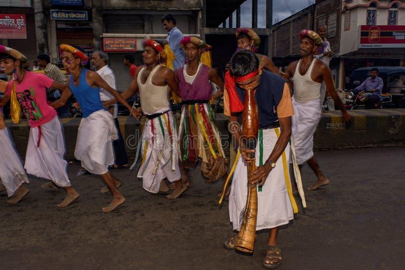 Tribal divotis dancing on occasion of baps swaminarayan mandir nagar yatra Dhule Maharashtra. 07-Aug-2010-Tribal divotis dancing on occasion of baps swaminarayan royalty free stock photos