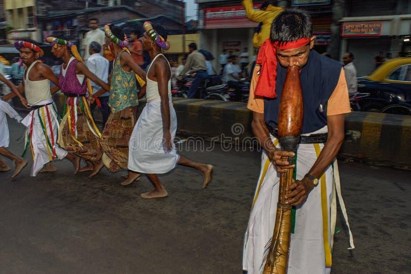 Tribal divotis dancing on occasion of baps swaminarayan mandir nagar yatra Dhule Maharashtra. 07-Aug-2010-Tribal divotis dancing on occasion of baps swaminarayan stock photo