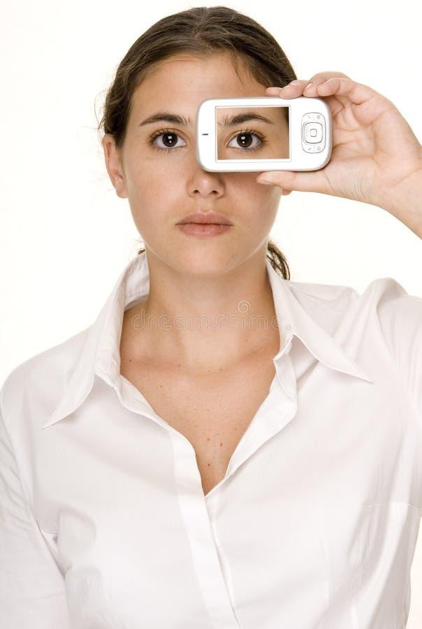 Auge am Telefon lizenzfreies stockbild