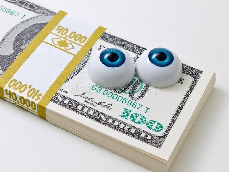 Augen auf dem Geld lizenzfreie stockfotografie