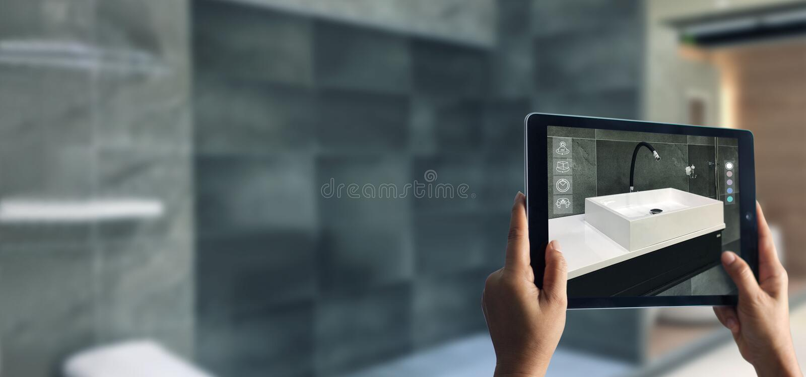 Augmented Reality bathroom planning. Sanitary ware. Hand holding digital tablet in real home background. AR application. A new way to experience products royalty free stock photos