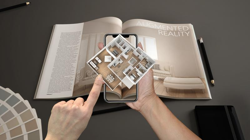 Augmented reality concept. Hand holding smartphone with AR application used to simulate 3d pop-up interactive house maps royalty free stock photo