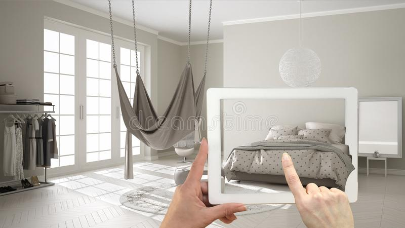 Augmented reality concept. Hand holding tablet with AR application used to simulate furniture and interior design products in real stock illustration