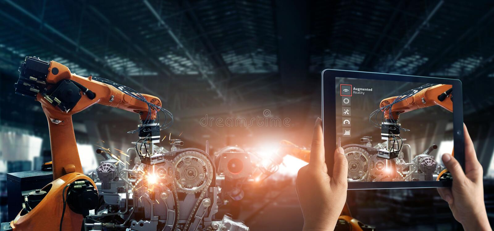 Augmented reality industry concept. Hand holding digital tablet use AR application to check and control welding robotics automatic royalty free stock photos