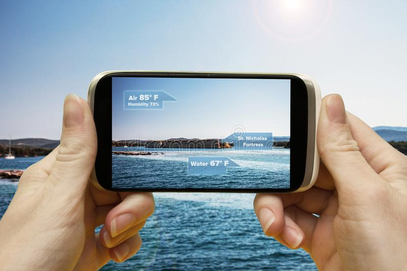 Augmented reality in the journey. Hand smartphone app to use AR, to check the relevant information about the spaces around the. Traveler. Phone in hand, close stock images