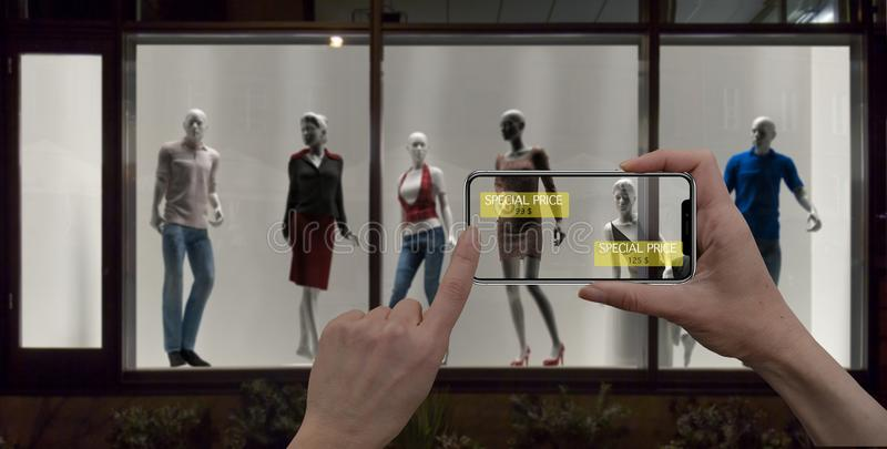 Augmented reality marketing concept. Hand holding digital tablet smart phone use AR application to check special sale price in ret royalty free stock photography