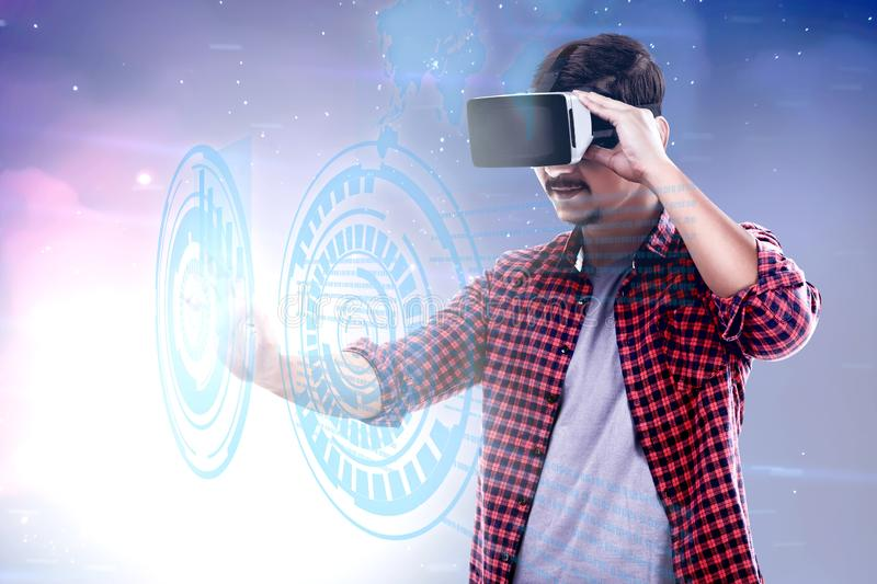 Augmented reality technology. Asian man touching a circle on digital interface with virtual reality device display the world map and binary code. Augmented royalty free stock photos
