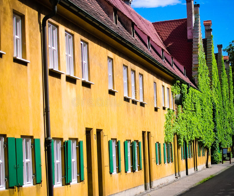 Augsburg building. Yellow sunlit building in Augsburg Germany stock image