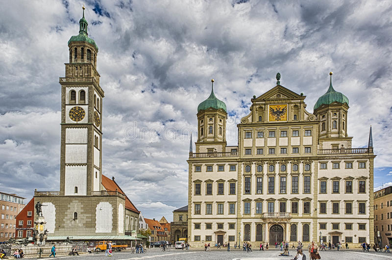 Augsburg City Hall and St. Peter am Perlach. Augsburg is a city in Swabia, Bavaria, Germany. It was a Free Imperial City for over 500 years, and is notable for stock photography