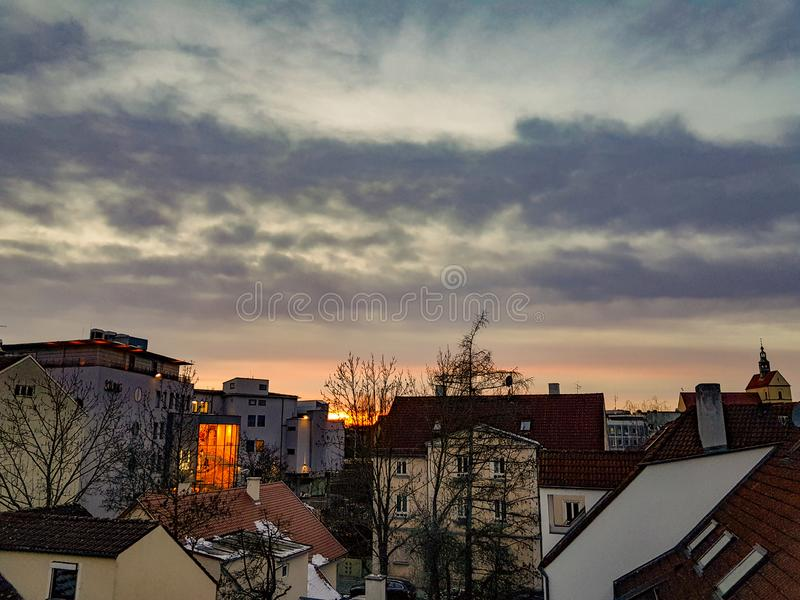 Augsburg, Germany skyline at sunset. Rooftop in skyline of Augsburg, Germany at sunrise with cloudy skies royalty free stock photography