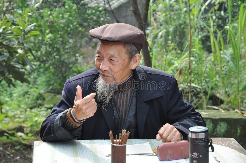 An Augur in china. The traditional fortune-teller and augury are very usual in china. Especially in the ancient rural areas of china stock images