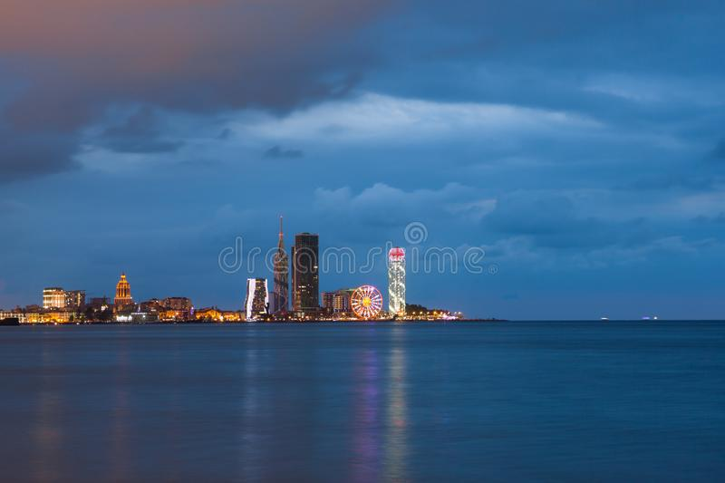 Panoramic view on the night illuminated buildings in Batumi, Georgia stock photo