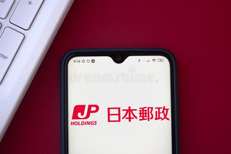 August 10, 2020, Brazil. In this photo illustration the Japan Post Holdings logo is displayed on a smartphone royalty free stock image