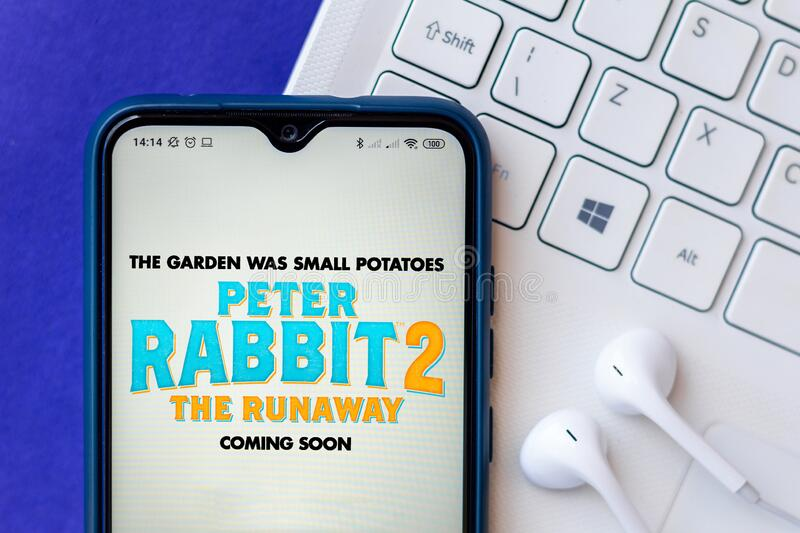 August 10, 2020, Brazil. In this photo illustration the Peter Rabbit 2: The Runaway movie logo is displayed on a smartphone royalty free stock photo