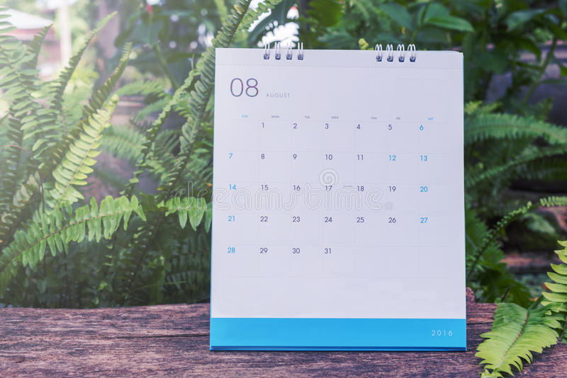 August Calendar 2016 on wood table,vintage filter stock photos