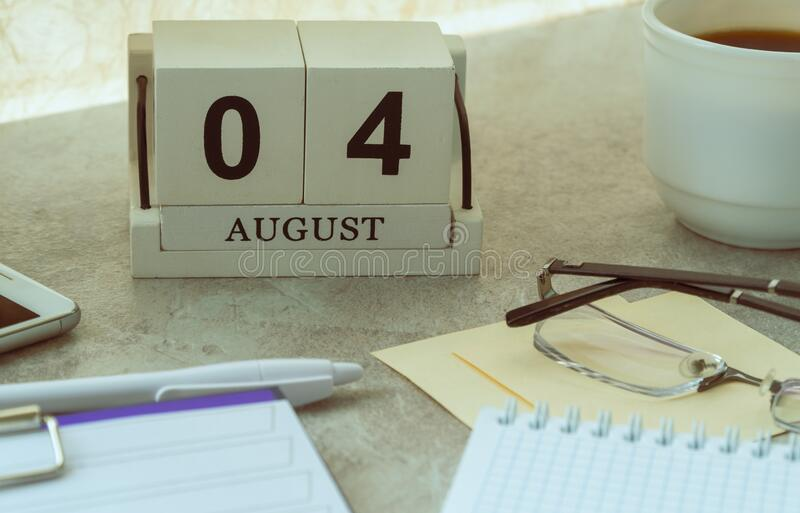 August 04, date on the calendar. Handmade wood cube with date month and day stock image
