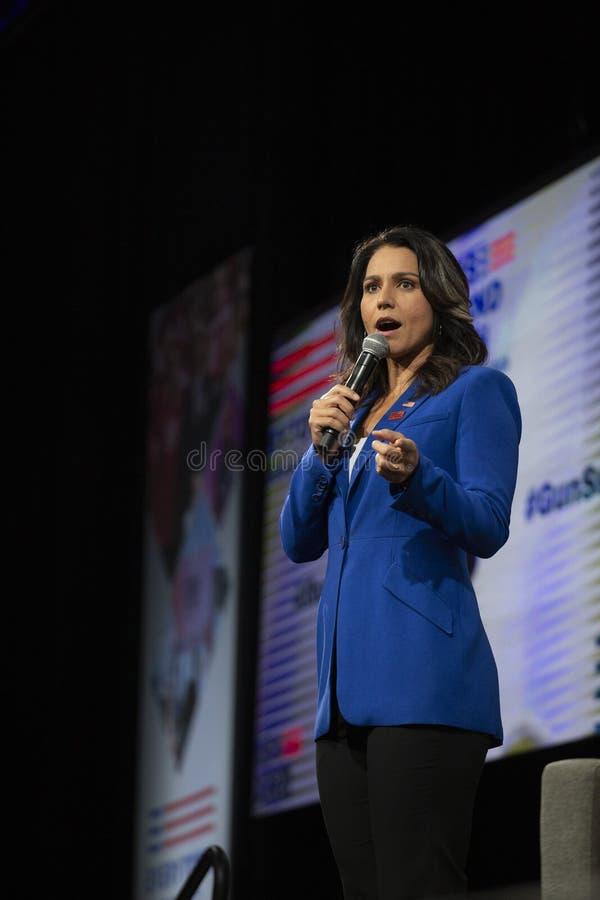 AUGUST 10, 2019-DES MOINES, IA/USA: Tulsi Gabbard speaks stock photos