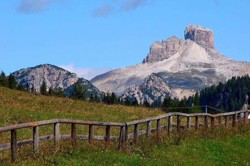 In August 2009, the Dolomites Italy were declared a UNESCO World Heritage Site. The name is from carbonate rock dolomite. Fences cliff stone peak landscape royalty free stock photo