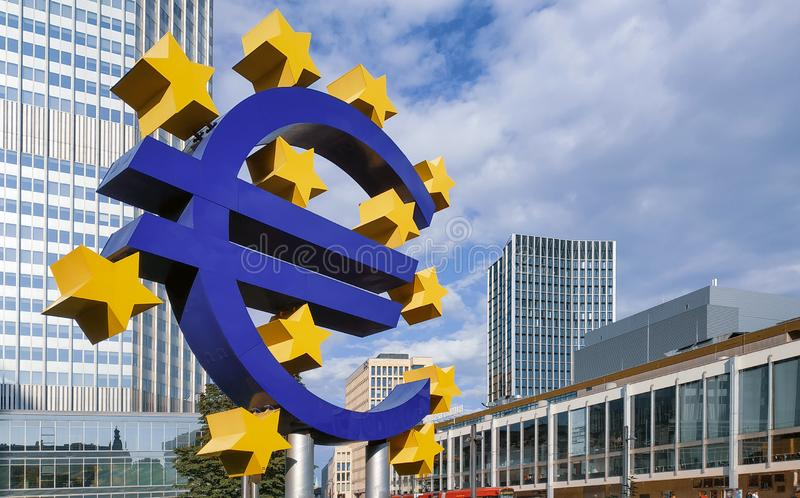 August, 2019, Euro sign at European Central Bank headquarters in the evening, business district in Frankfurt am Main, Germany royalty free stock photography