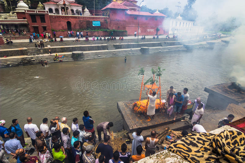 August 18, 2014 - Funeral pyre in the Bagmati river in Kathmandu stock photo