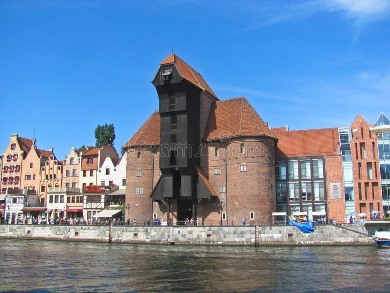 11 August, 2019, Gdansk, Poland. Gdansk old city iwith medieval port crane Zuraw and Motlawa River royalty free stock photography