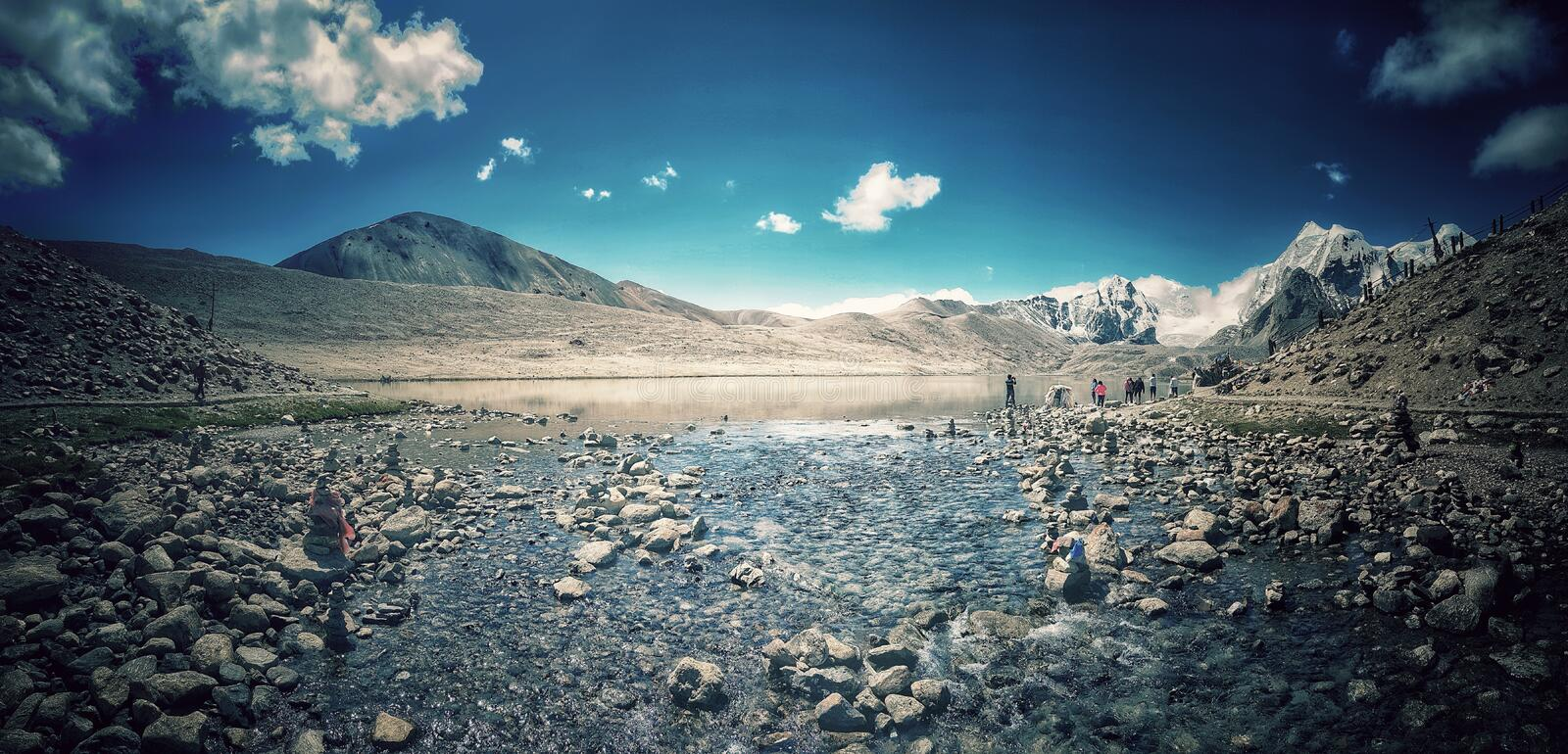 August 2018, Gurudongmar Lake., Sikkim, India. A panoramic landscape showing the tail end of gurudongmar lake with himalayan mount royalty free stock photography