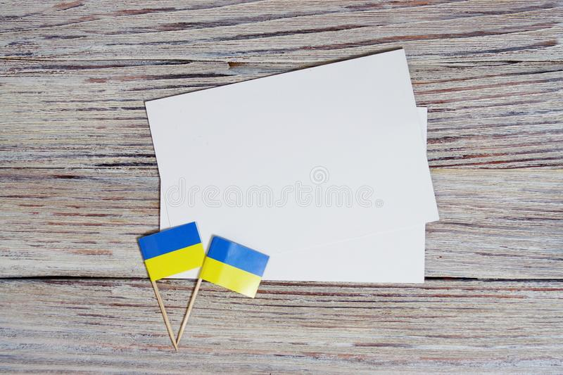 24 August independence Day of Ukraine the concept of the Day of memory of freedom and patriotism. Mini flags with two sheets of stock images