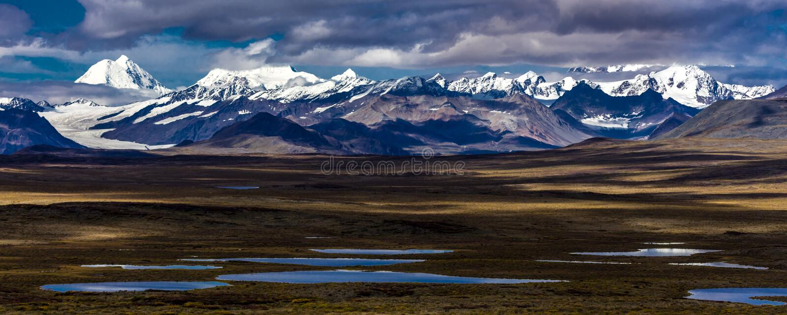 AUGUST 26, 2016 - Lakes of Central Alaskan Range - Route 8, Denali Highway, Alaska, a dirt road offers stunning views of Mnt. Hess. Mountain, & Mt. Hayes and royalty free stock images