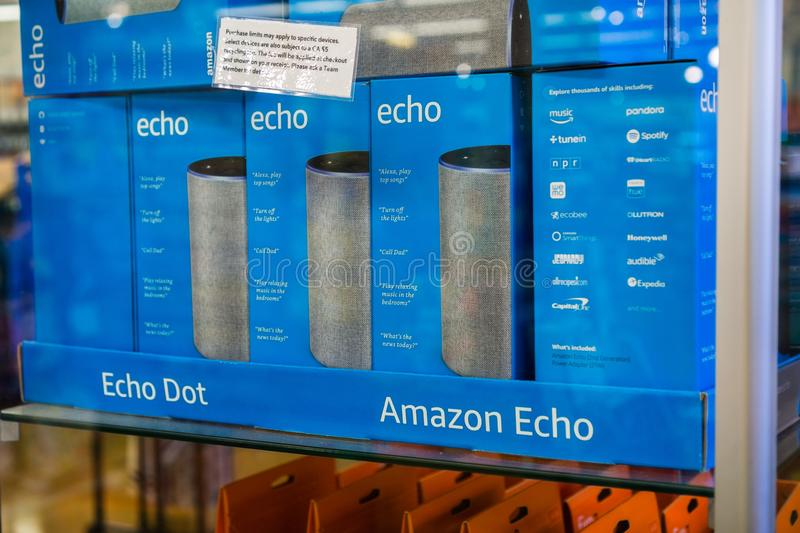 August 2, 2018 Los Altos / CA / USA - Amazon Echo boxes inside a glass display located in one of the Whole Foods stores in San. Francisco bay area royalty free stock image