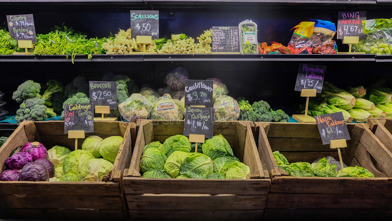 August 9, 2016 - Los Angeles, USA : Fresh vegetable stall of greengrocery in Grand Central Market, famous food place in downtown stock images