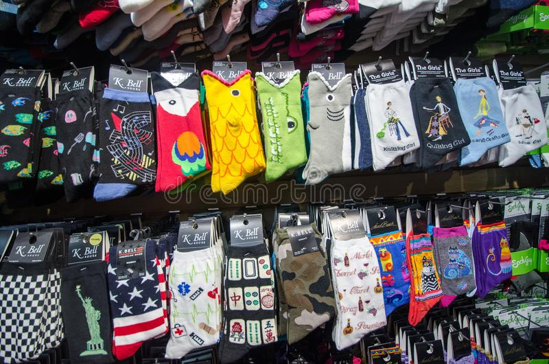MONTEREY CALIFORNIA: A gift shop in Cannery Row sells colorful novelty socks, popular item with tourists to the. A gift shop in Cannery Row sells colorful stock images