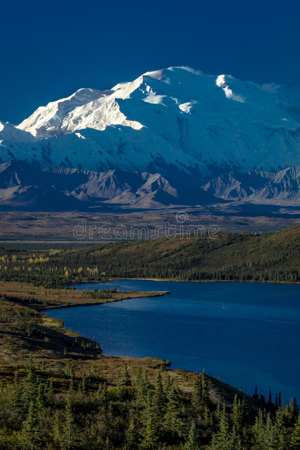 AUGUST 28, 2016 - Mount Denali and Wonder Lake, previously known as Mount McKinley, the highest mountain peak in North America, at. 20, 310 feet above sea level royalty free stock photography
