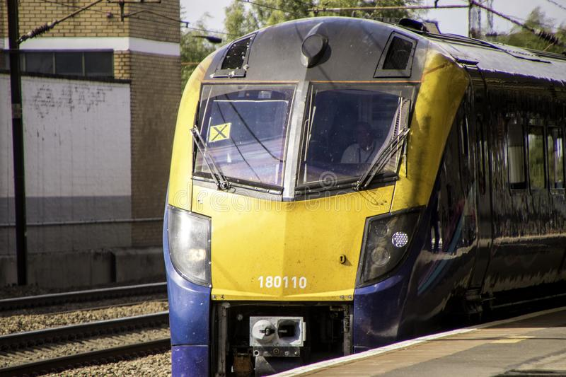 Train Travel. August 17, 2019 – Retford, United Kingdom. Just one of the hundreds of fast trains, passing Retford Train Station, that run up and down the royalty free stock photography