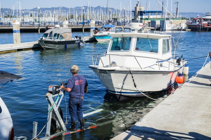 August 26, 2017 Richmond/CA/USA - Taking a motor boat out of the water after a fishing trip in San Francisco bay stock photo