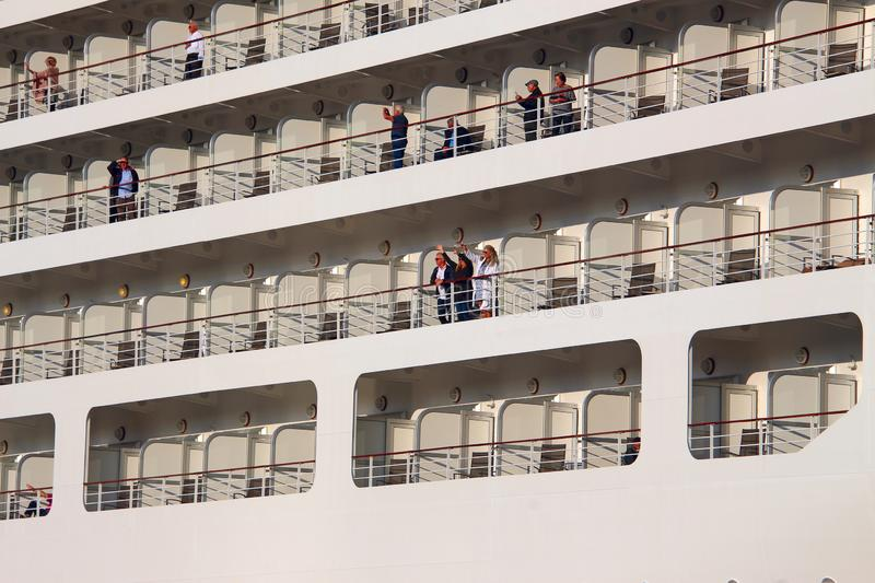 Happy tourists aboard an ocean liner royalty free stock image