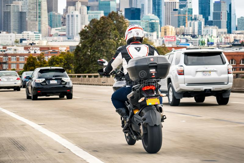 August 10, 2019 San Francisco / CA / USA - Motorcyclist riding on the freeway towards downtown San Francisco stock photo