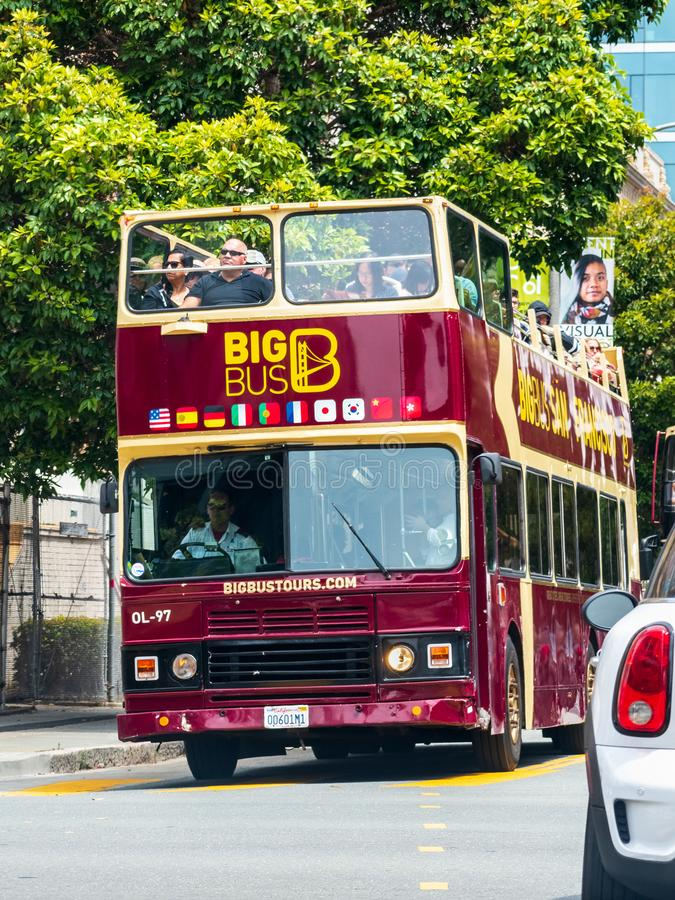 August 10, 2019 San Francisco / CA / USA - Sightseeing tour bus travelling through San Francisco downtown stock image
