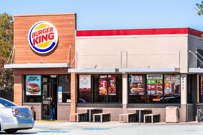 August 19, 2019 San Mateo / CA / USA - Burger King fast food restaurant entrance, advertising several offers among which the. Impossible Whopper, a new vegan stock photography