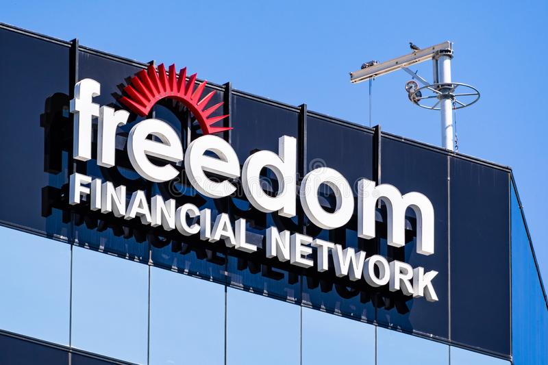 August 24, 2019 San Mateo / CA / USA - Close up of Freedom Financial Network sign at their headquarters in Silicon Valley; Freedom. Financial Network is an royalty free stock photos