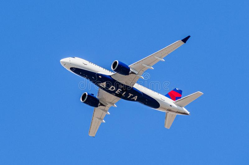 August 1, 2019 Santa Clara / CA / USA - Delta Airlines aircraft in flight; the Delta Logo visible on the airplanes` underbelly; royalty free stock image
